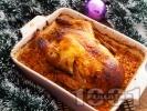 Рецепта Пълнено коледно пиле с ориз и дробчета, печено в тава с кисело зеле на фурна